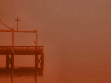 pier in foggy red